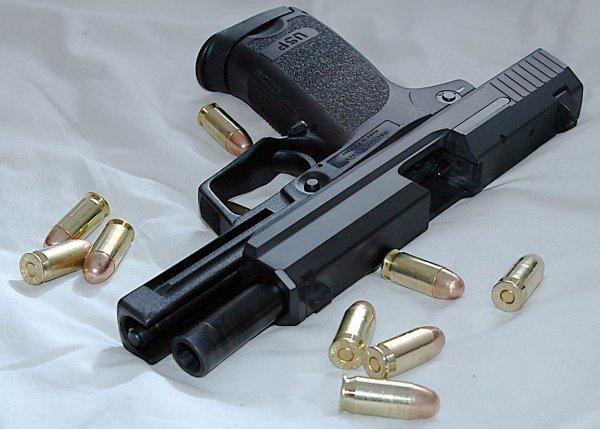 HK USP pistol and .45 ACP cartridges