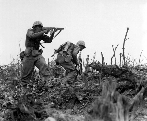 Marine fires Japanese position using M1 (Okinawa in 1945)